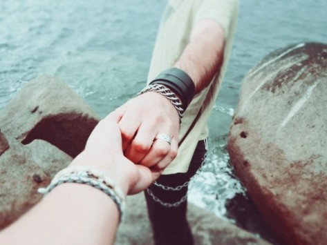 couple-holding-hands-near-rocks-by-sea.jpg